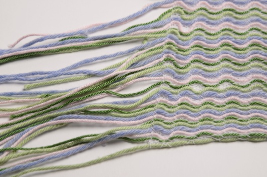 Knitted on a domestic knitting machine: Cotton
